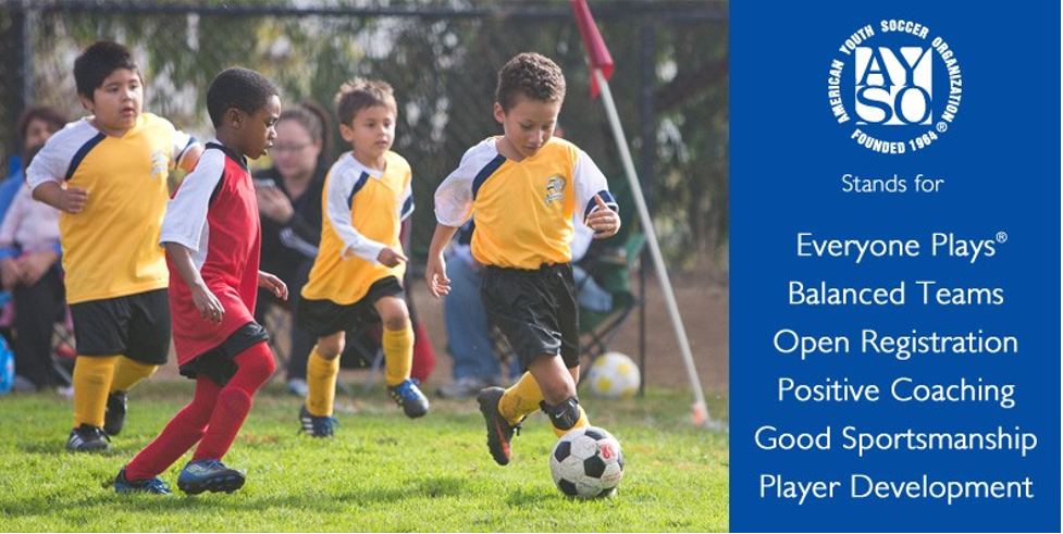 A group of young boys playing football Description automatically generated with medium confidence
