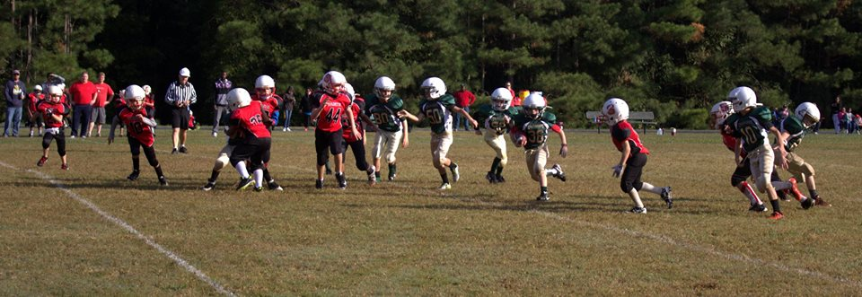 The Holly Springs 10U youth tackle football team play against the North Wake Saints youth tackle football team