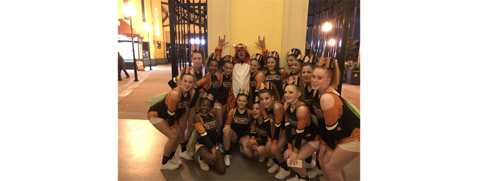 A1 pumped with their mascot before they take the mats at Nationals!