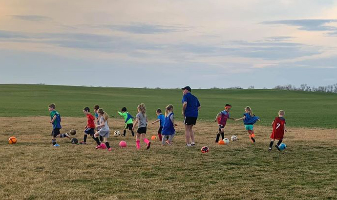 Juniors - 6 and 7 year old kids playing soccer