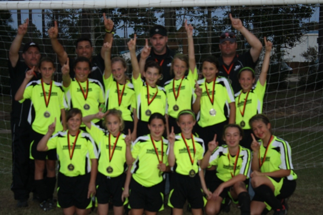 Congrats to TSA UNITED 2010 GU12 Champions at Mandeville Midnight Madness